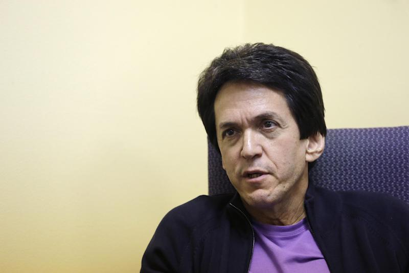 FILE - In this Nov. 7, 2013 file photo, author Mitch Albom is interviewed in Highland Park, Mich. Albom is an award-winning sports writer, best-selling author, radio host, TV pundit, songwriter and international philanthropist. Albom has launched a drive to rebuild 10 libraries in Tacloban, a central Philippine city ravaged by Typhoon Haiyan in November. National Book Store Foundation, his Philippine partner in the project, said Tuesday that Albom has pledged to raise $160,000, starting with his own contribution of $10,000 for the libraries. (AP Photo/Carlos Osorio, File)