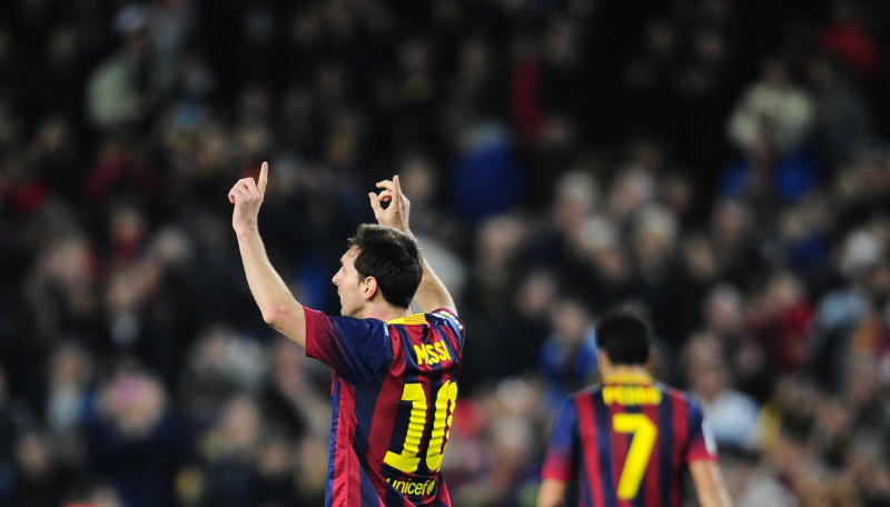 FC Barcelona's Lionel Messi, from Argentina, reacts after scoring against Rayo Vallecano during a Spanish La Liga soccer match at the Camp Nou stadium in Barcelona, Spain, Saturday, Feb. 15, 2014. (AP Photo/Manu Fernandez)