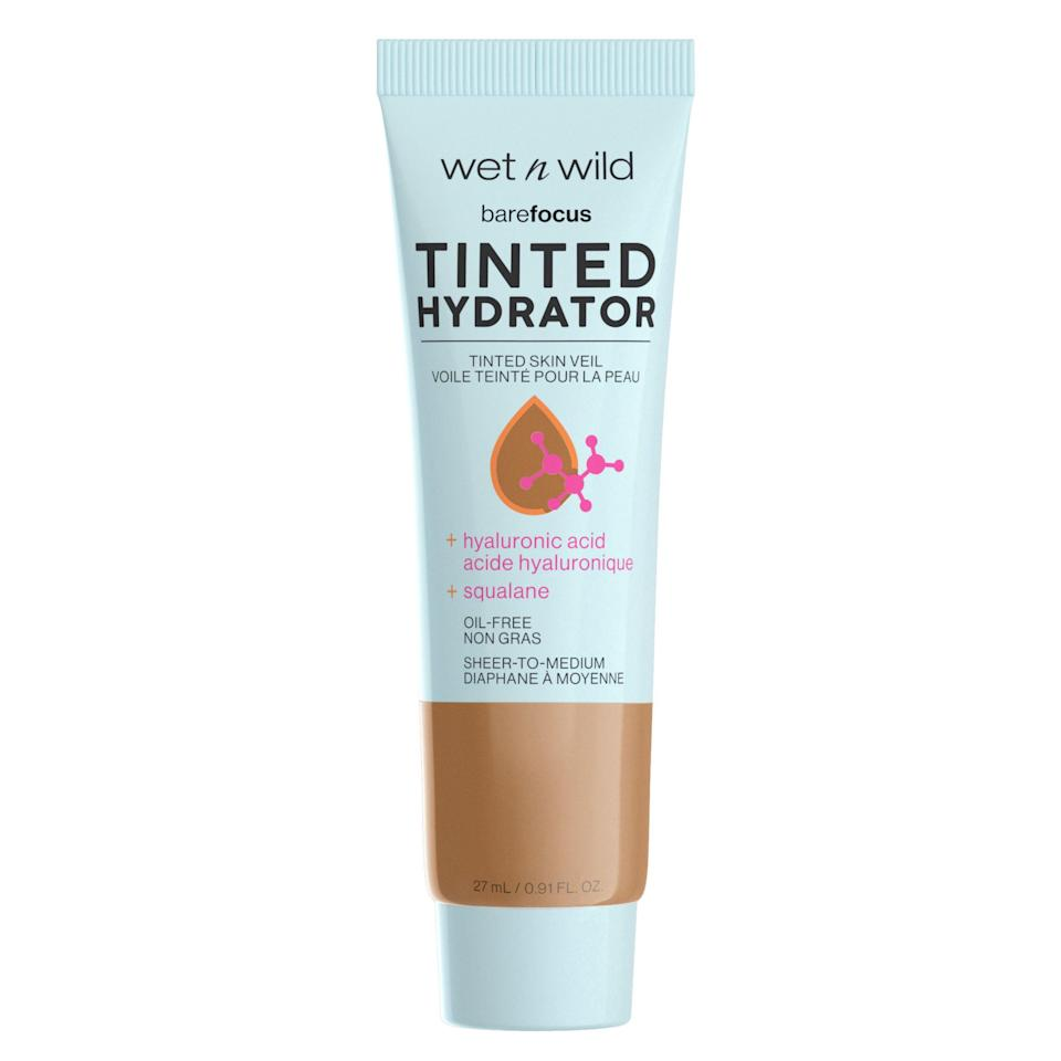 """<p><strong>wet n wild</strong></p><p>walmart.com</p><p><strong>$4.98</strong></p><p><a href=""""https://go.redirectingat.com?id=74968X1596630&url=https%3A%2F%2Fwww.walmart.com%2Fip%2F414609454&sref=https%3A%2F%2Fwww.thepioneerwoman.com%2Fbeauty%2Fskin-makeup-nails%2Fg36969963%2Fbest-drugstore-tinted-moisturizer%2F"""" rel=""""nofollow noopener"""" target=""""_blank"""" data-ylk=""""slk:Shop Now"""" class=""""link rapid-noclick-resp"""">Shop Now</a></p><p>Hydration meets coverage in this popular pick from Wet n Wild. It boasts moisture-locking ingredients like hyaluronic acid and squalane while also touting a semi-matte finish and buildable coverage—say goodbye to redness, texture, and discoloration!</p>"""
