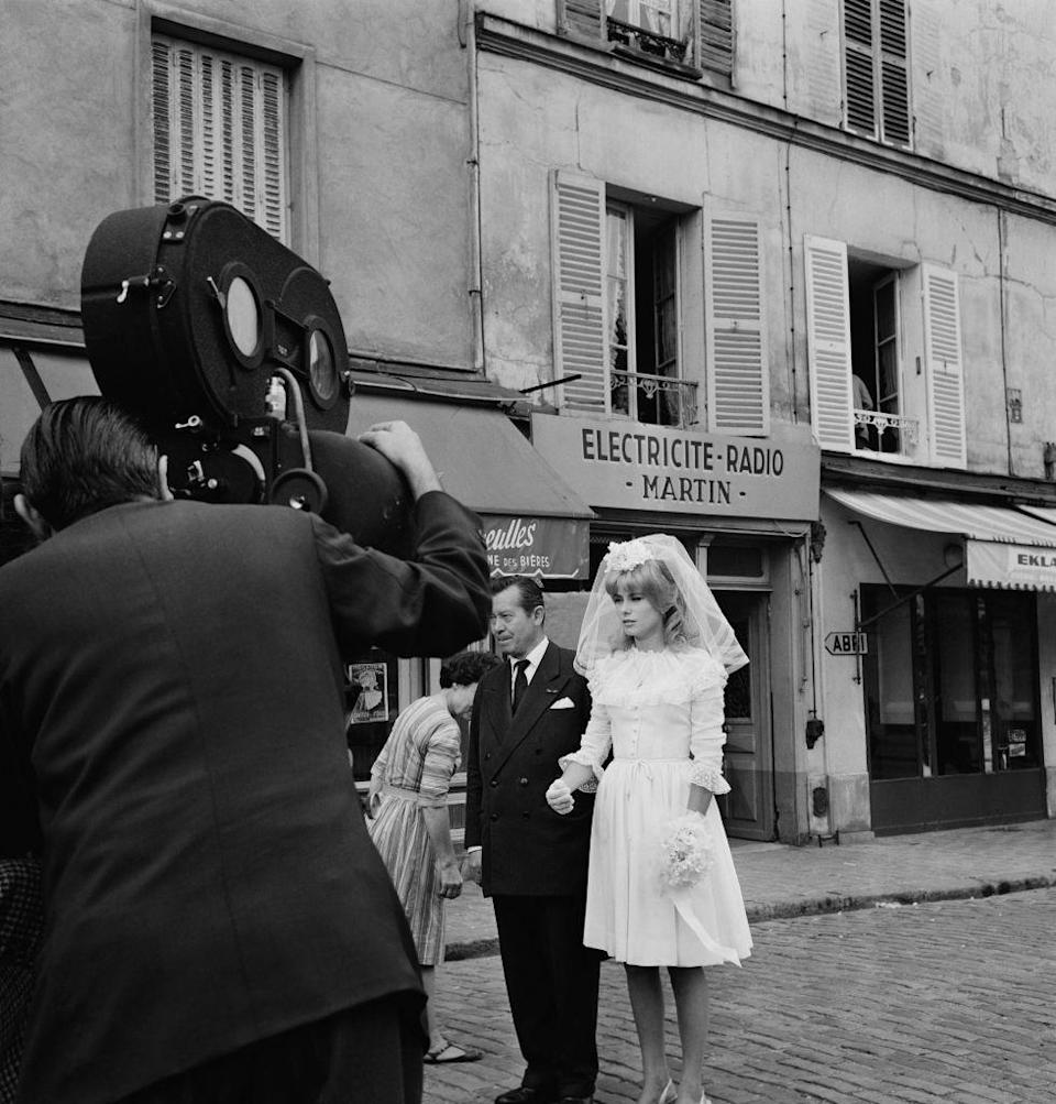 <p>French actress Catherine Deneuve is seen filming the famous wedding scene in Roger Vadim's movie <em>Vice and Virtue</em>. Vadim, a well-known French director, was involved with the actress at the time. The two eventually split and Vadim married Jane Fonda a year later. </p>