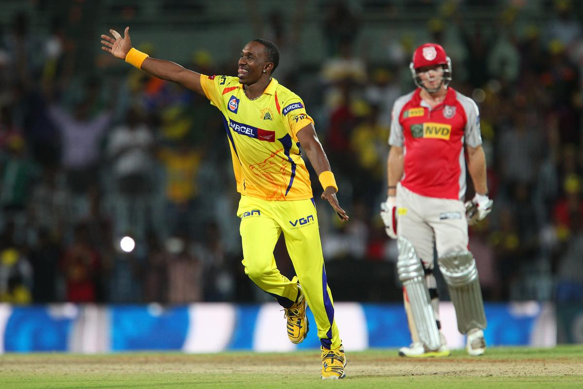 Dwayne Bravo celebrates the win during match 45 of the Pepsi Indian Premier League between The Chennai Superkings and the Kings XI Punjab held at the MA Chidambaram Stadium in Chennai on the 2nd May 2013..Photo by Ron Gaunt-IPL-SPORTZPICS   .. .Use of this image is subject to the terms and conditions as outlined by the BCCI. These terms can be found by following this link:..https://ec.yimg.com/ec?url=http%3a%2f%2fwww.sportzpics.co.za%2fimage%2fI0000SoRagM2cIEc&t=1498442668&sig=eviDUHQvwKsHRTfKXjYyxg--~C