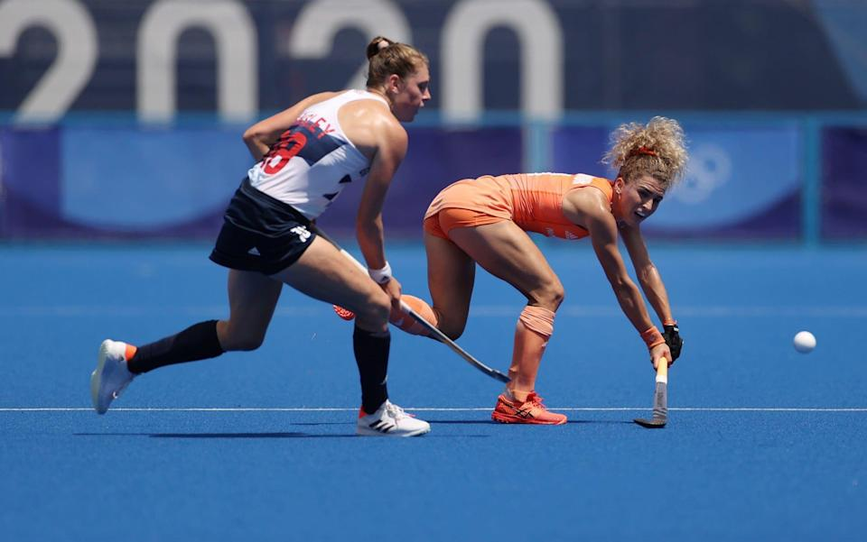 The Netherlands' Maria Verschoor up against Giselle Ansley - GETTY IMAGES