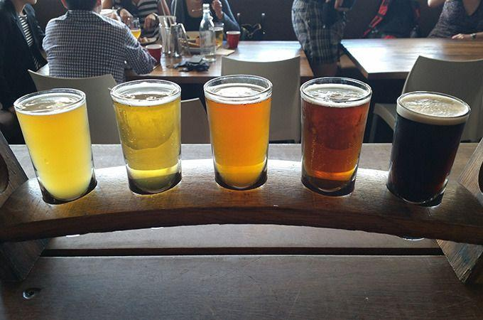 A tasting paddle at 4 Pines Brewery is a great way to sample the local beers on offer. Photo: Allison Wallace