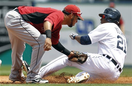 Houston Astros shortstop Marwin Gonzalez, left, tags out Detroit Tigers' Austin Jackson who was attempting to steal second base in the second inning during a spring training baseball game in Lakeland, Fla., Sunday, April 1, 2012. (AP Photo/Paul Sancya)