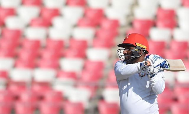 Afghanistan's Mohammad Shahzad (pictured March 2019) put on 150 for the second wicket (AFP Photo/Money SHARMA)