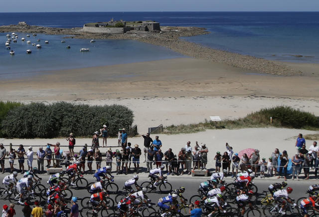 The pack passes along the west coast during the fifth stage of the Tour de France cycling race over 204.5 kilometers (127 miles) with start in Lorient and finish in Quimper, France, Wednesday, July 11, 2018. (AP Photo/Christophe Ena )