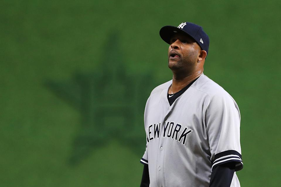 HOUSTON, TEXAS - OCTOBER 13: CC Sabathia #52 of the New York Yankees leaves the game in the tenth inning against the Houston Astros in game two of the American League Championship Series at Minute Maid Park on October 13, 2019 in Houston, Texas. (Photo by Mike Ehrmann/Getty Images)