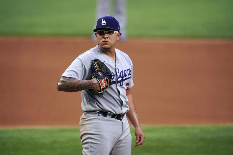 ARLINGTON, TX - OCTOBER 14:  Julio Urías #7 of the Los Angeles Dodgers looks on during Game 3 of the NLCS between the Atlanta Braves and the Los Angeles Dodgers at Globe Life Field on Wednesday, October 14, 2020 in Arlington, Texas. (Photo by Cooper Neill/MLB Photos via Getty Images)