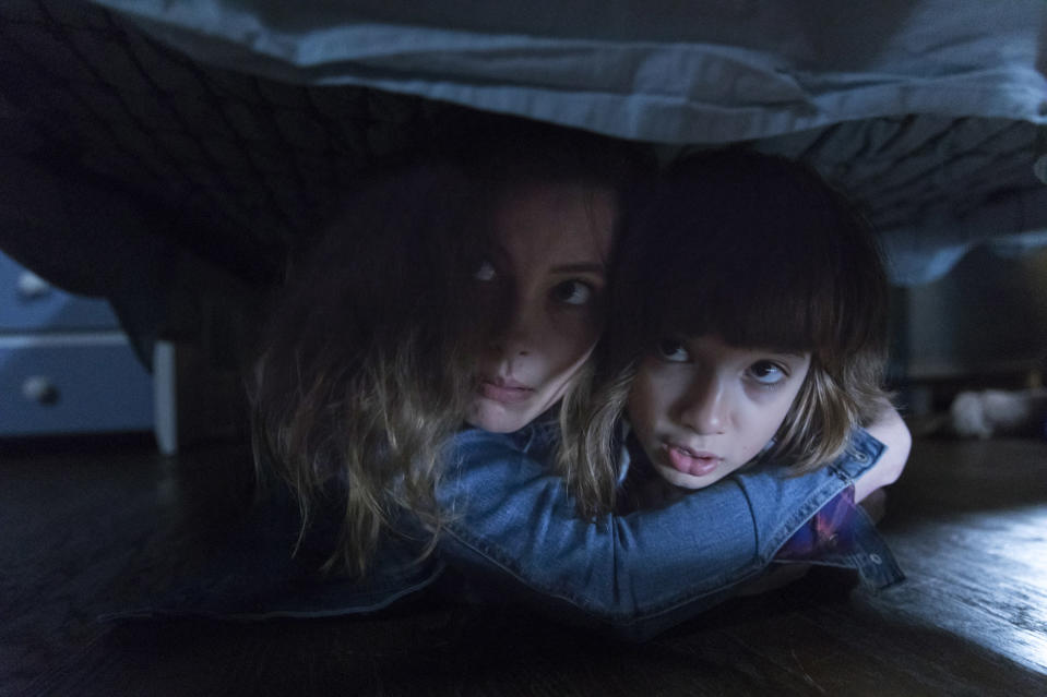 "This image released by Focus Features shows Gillian Jacobs, left, and stars Azhy Robertson in a scene from ""Come Play."" The biggest theater release since reopening began in late August is ""Tenet,"" which is still playing on around 1,800 screens. Current offerings widely available also include a Liam Neeson thriller, ""Honest Thief,"" a PG-13 horror movie with Gillian Jacobs called ""Come Play."" (Jasper Savage/Amblin Partners - Focus Features via AP)"