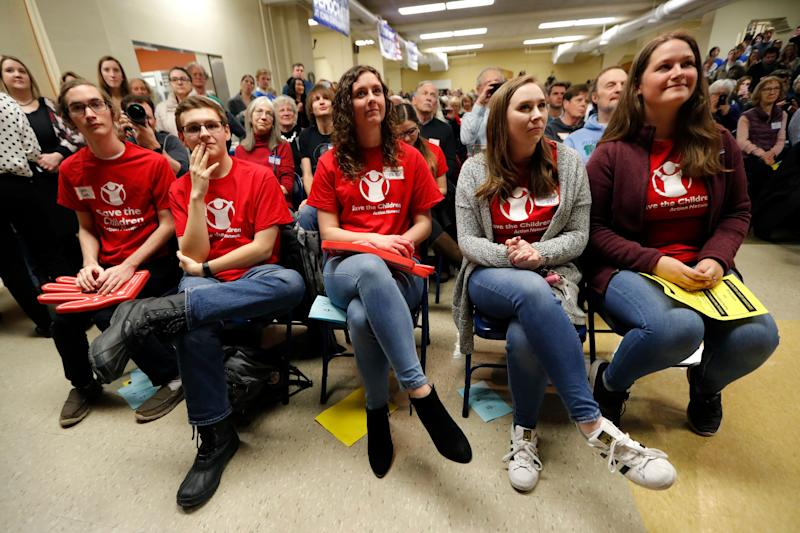 Students listen to Democratic presidential candidate Sen. Kamala Harris speak at the Story County Democrats' annual soup supper fundraiser, Saturday, Feb. 23, 2019, in Ames, Iowa. (AP Photo/Charlie Neibergall)