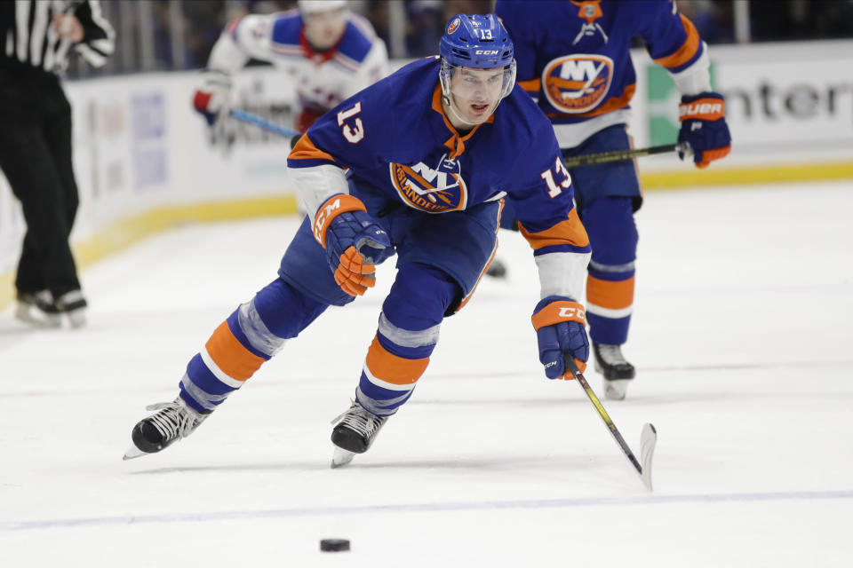 New York Islanders' Mathew Barzal (13) chases down the puck during the second period of an NHL hockey game against the New York Rangers Thursday, Jan. 16, 2020, in Uniondale, N.Y. (AP Photo/Frank Franklin II)