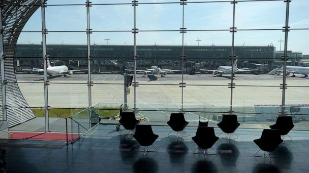 PHOTO: (FILES) This file photo taken on May 12, 2020, through a window shows planes on the tarmac at the Terminal 2E at the Paris-Charles de Gaulle airport in Roissy-en-France.  (Eric Piermont/AFP via Getty Images)
