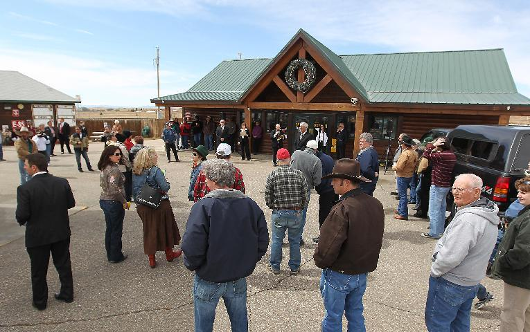 FILE - In this April 5, 2012 file photo, a group of nearly 50 look on as the town of Buford is auctioned for $900,000 in Buford, Wyo. Vietnamese businessman Pham Dinh Nguyen flew to the U.S. for the first time, drove to a tiny, frigid trading outpost and bought his own piece of the American dream: Buford, Wyoming _ population 1. Nguyen, who bid $900,000 for Buford, runs a trade and distribution company in southern Ho Chi Minh City. He said that although he is not exactly sure what he will do with the town just off Interstate 80, he expects to use it to sell items made in Vietnam. (AP Photo/The Wyoming Tribune Eagle, Michael Smith, File)