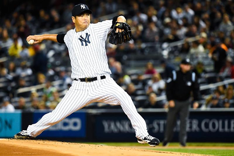 Hiroki Kuroda, pictured pitching for the New York Yankees against the Toronto Blue Jays in September 2014, has returned to play baseball in Japan after seven years in Major League Baseball