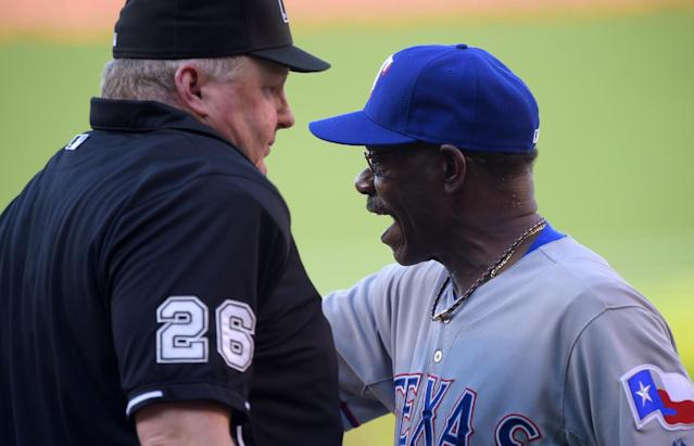 Texas Rangers manager Ron Washington, right, argues with home plate umpire Bill Miller after being thrown out of the game while arguing a play at home plate after it had already been deiced by replay during the first inning of a baseball game against the Los Angeles Angels, Sunday, June 22, 2014, in Anaheim, Calif. (AP Photo/Mark J. Terrill)