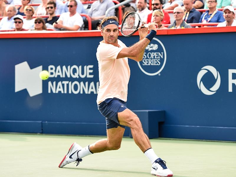 Roger Federer of Switzerland prepares to hit a return against David Ferrer of Spain during day seven of the Rogers Cup presented by National Bank at Uniprix Stadium