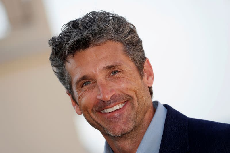 """FILE PHOTO: Actor Patrick Dempsey poses during a photocall for the television series """"Devils"""" during the annual MIPCOM television programme market in Cannes"""