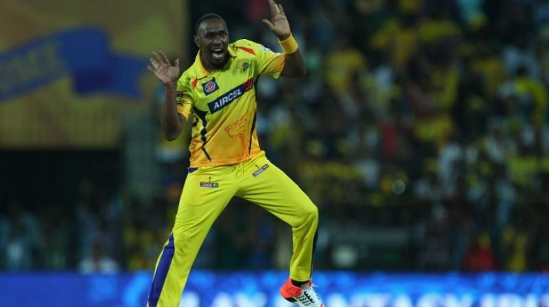 Dwayne Bravo dances after taking a wicket