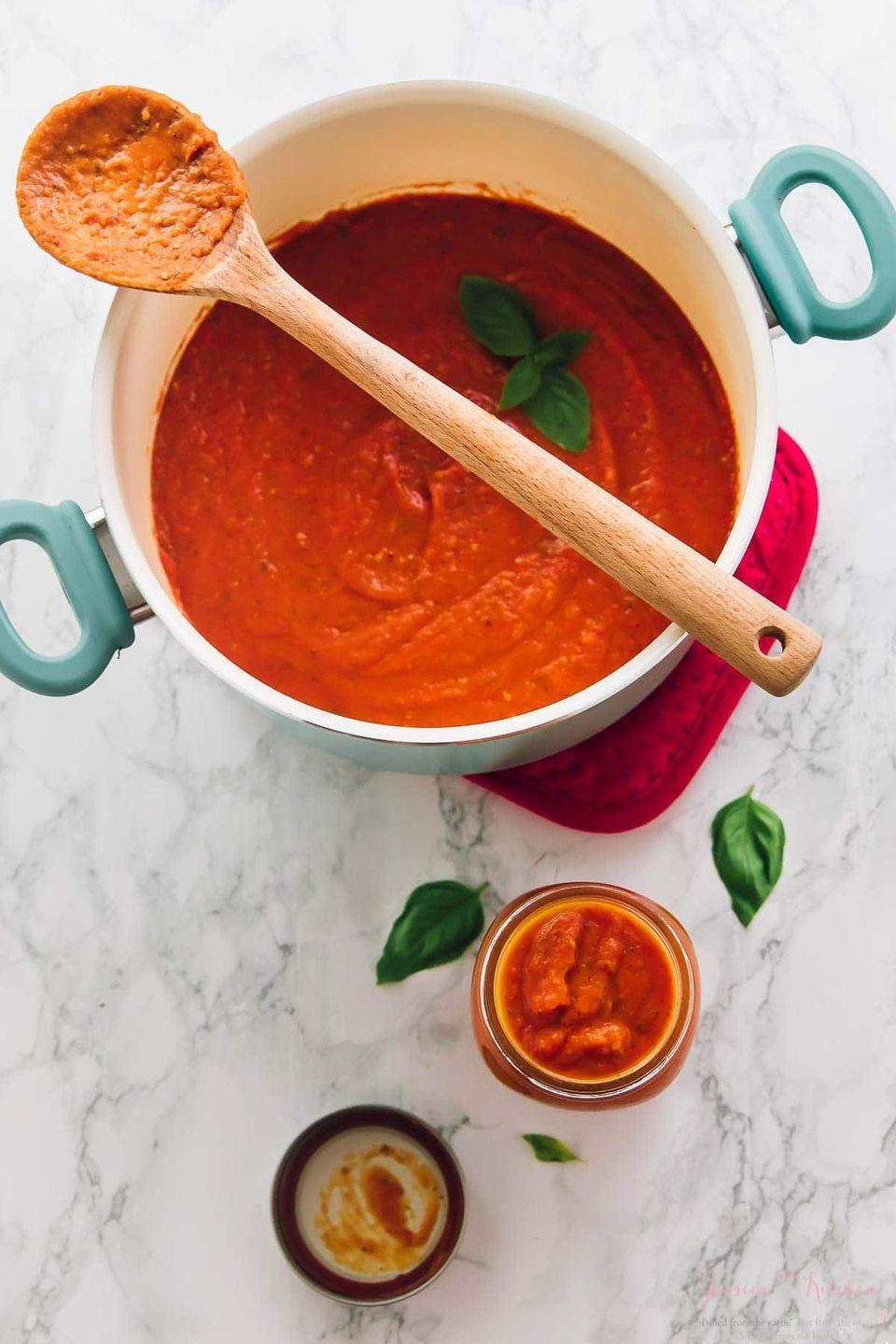 """<p>Homemade sauce is the perfect way to use up a bounty of summer tomatoes. Toss it with fresh pasta or spoon it over meatballs for an easy weeknight dinner. </p><p><strong>Get the recipe at <a href=""""https://jessicainthekitchen.com/homemade-tomato-sauce-roasted-garlic-easy/"""" rel=""""nofollow noopener"""" target=""""_blank"""" data-ylk=""""slk:Jessica in the Kitchen"""" class=""""link rapid-noclick-resp"""">Jessica in the Kitchen</a>.</strong></p><p><a class=""""link rapid-noclick-resp"""" href=""""https://go.redirectingat.com?id=74968X1596630&url=https%3A%2F%2Fwww.walmart.com%2Fsearch%2F%3Fquery%3Dmason%2Bjars&sref=https%3A%2F%2Fwww.thepioneerwoman.com%2Ffood-cooking%2Fmeals-menus%2Fg36500577%2Ftomato-recipes%2F"""" rel=""""nofollow noopener"""" target=""""_blank"""" data-ylk=""""slk:SHOP MASON JARS"""">SHOP MASON JARS</a></p>"""