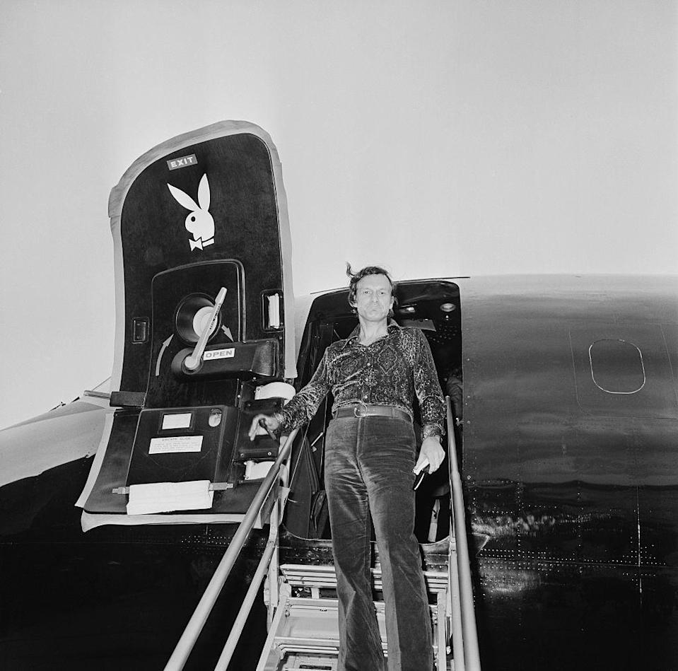 <p>Hugh Hefner boards the Playboy jet at London's Heathrow Airport in 1971.</p>