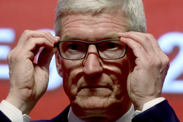 """Apple CEO Tim Cook attends the Economic Summit held for the China Development Forum in Beijing, China, Saturday, March 23, 2019. Cook says he's """"extremely bullish"""" about the global economy based on the amount of innovation being carried out, and he's urging China to continue to """"open up."""" (AP Photo/Ng Han Guan)"""
