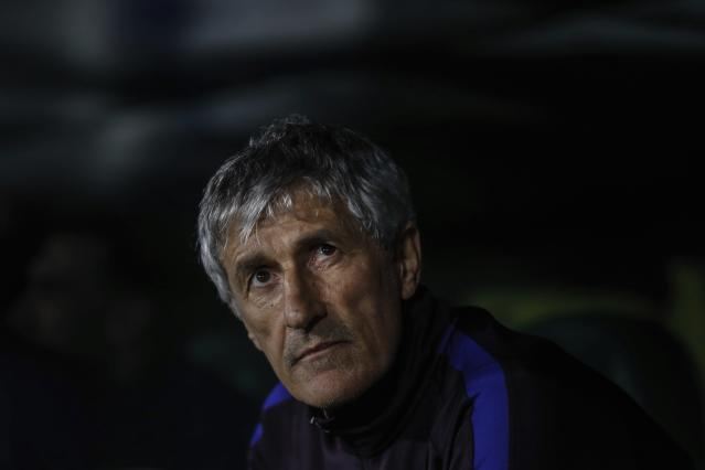 Barcelona's head coach Quique Setien sits on the bench during La Liga soccer match between Betis and Barcelona at the Benito Villamarin stadium in Seville, Spain, Sunday, Feb. 9, 2020. (AP Photo/Miguel Morenatti)