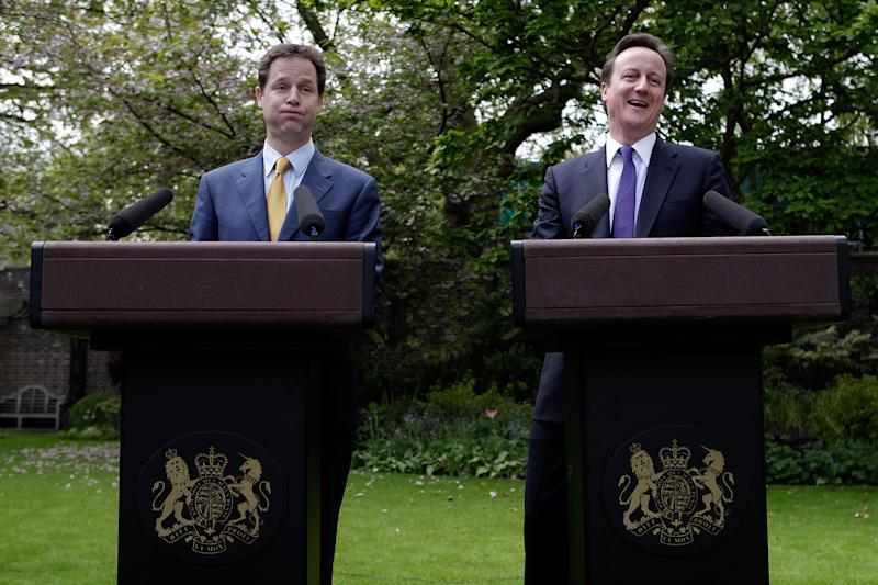 LONDON, ENGLAND - MAY 12: Prime Minister David Cameron (R) and Deputy Prime Minister Nick Clegg share a joke as they hold their first joint press conference in the Downing Street garden on May 12, 2010 in London, England. On his first full day as Prime Minister, David Cameron has made a series of cabinet appointments including Nick Clegg as Deputy Prime Minister. The Conservatives and Liberal Democrats have now agreed to lead the country with a fully inclusive coalition government. (Photo by Christopher Furlong - WPA Pool /Getty Images)