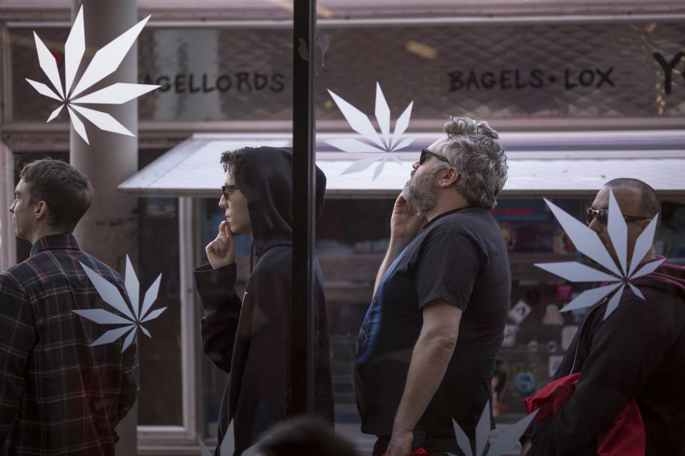 People stand in line to get into MedMen, one of the two Los Angeles area pot shops that began selling marijuana for recreational use under the new California marijuana law today, on January 2, 2018 in West Hollywood, California. (Photo by David McNew/Getty Images)
