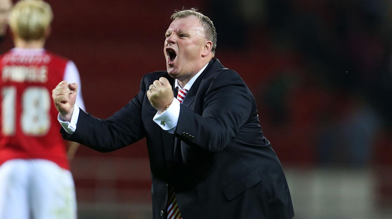 Rotherham's Steve Evans celebrates after the Capital One Cup, First Round match at the New York Stadium, Rotherham.