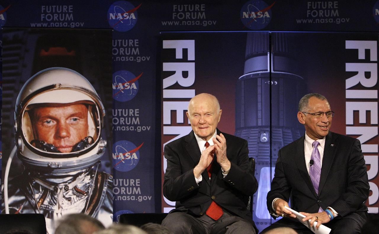 """Sen. John Glenn, left, and Charles Bolden, administrator from NASA headquarters, talk, via satellite, with the astronauts on the International Space Station, before the start of a roundtable discussion titled """"Learning from the Past to Innovate for the Future"""" Monday, Feb. 20, 2012, in Columbus, Ohio. Glenn was the first American to orbit Earth, piloting Friendship 7 around it three times in 1962, and also became the oldest person in space, at age 77, by orbiting Earth with six astronauts aboard shuttle Discovery in 1998. (AP Photo/Jay LaPrete)"""