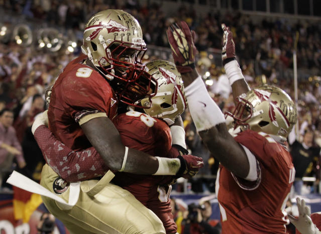 FILE - In this Dec. 1, 2012 file photo, Florida State's Karlos Williams (9) celebrates his interception of a Georgia Tech pass with Everett Dawkins (93) and Vince Williams (11) during the second half of the ACC Championship college football game in Charlotte, N.C. With three weeks left before college football's selection Sunday, Alabama and Florida State control the race to Pasadena, Calif., where the BCS championship game will be played Jan. 6. (AP Photo/Chuck Burton, File)