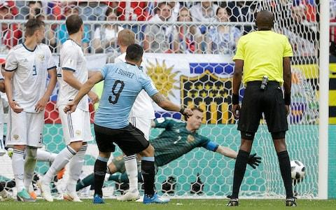 Uruguay's Luis Suarez scores his side's first goal during the group A match between Uruguay and Russia at the 2018 soccer World Cup at the Samara Arena in Samara, Russia, Monday, June 25, 2018 - Credit: AP