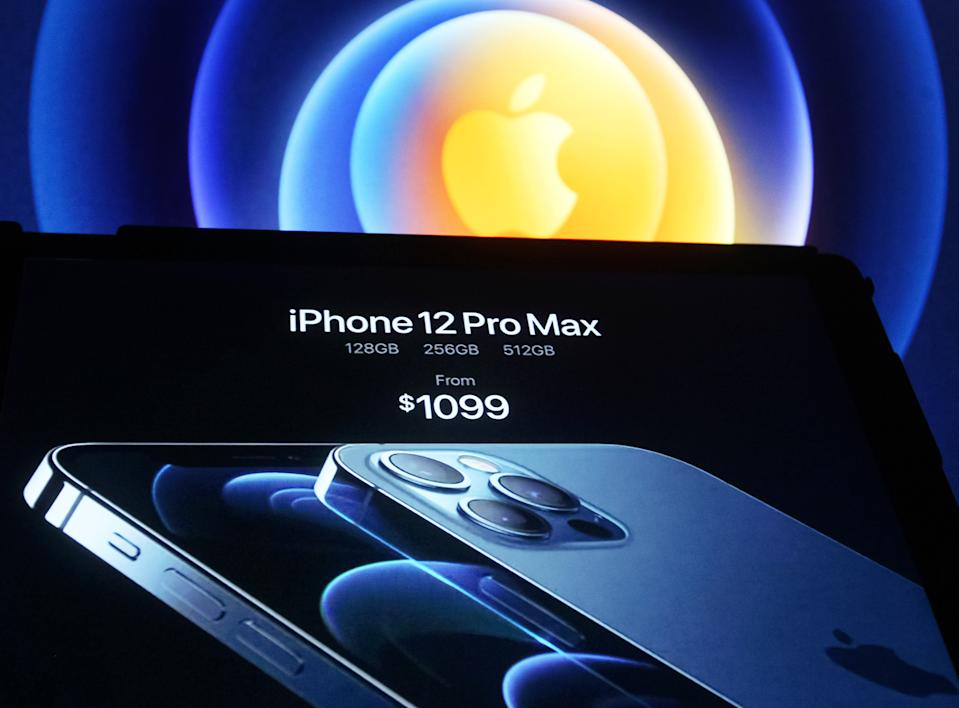 UKRAINE - 2020/10/13: In this photo illustration a screenshot from Apple's launch promotional material of the the new iPhone12 seen displayed on a Ipad tablet screen with the apple logo in the background. (Photo Illustration by Pavlo Gonchar/SOPA Images/LightRocket via Getty Images)