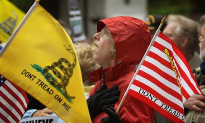Tea Partiers sing the National Anthem during a rally in Chicago last spring.