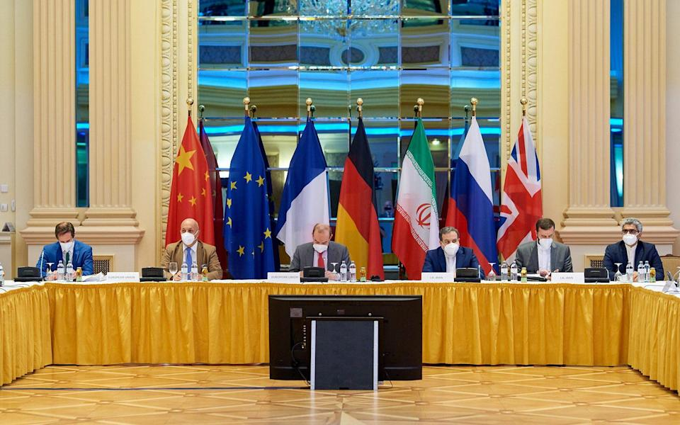 European External Action Service (EEAS) Deputy Secretary General Enrique Mora and Iranian Deputy at Ministry of Foreign Affairs Abbas Araghchi wait for the start of talks on reviving the 2015 Iran nuclear deal in Vienna