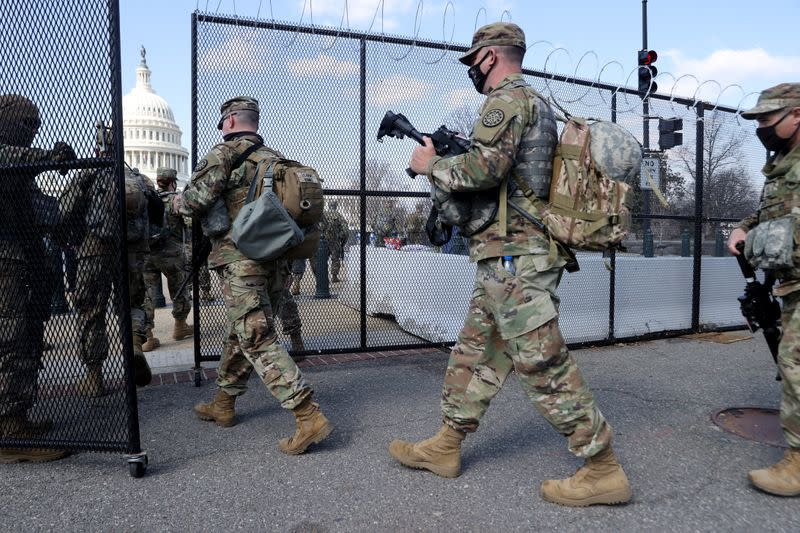 FILE PHOTO: National Guard soldiers patrol the grounds of the U.S. Capitol in Washington
