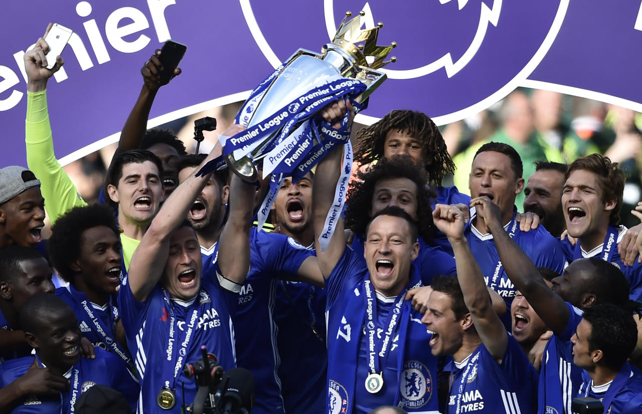 "Britain Football Soccer - Chelsea v Sunderland - Premier League - Stamford Bridge - 21/5/17 Chelsea's John Terry, Gary Cahill and team mates celebrate with the trophy after winning the Premier League  Reuters / Hannah McKay Livepic EDITORIAL USE ONLY. No use with unauthorized audio, video, data, fixture lists, club/league logos or ""live"" services. Online in-match use limited to 45 images, no video emulation. No use in betting, games or single club/league/player publications.  Please contact your account representative for further details."