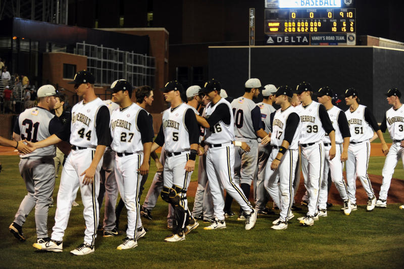 Vanderbilt and Belmont players shake hands after an NCAA regional college baseball tournament game won by Vanderbilt 10-0 on Friday, June 3, 2011, in Nashville, Tenn. (AP Photo/Mike Strasinger)