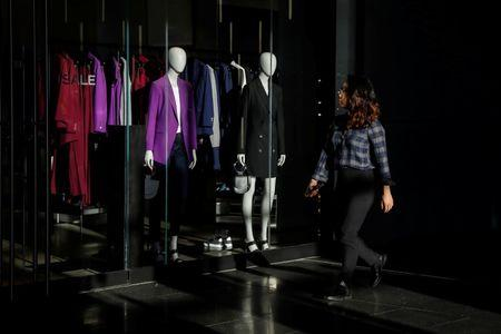 A woman shops at Brookfield Place in Lower Manhattan in New York City, U.S., December 1, 2017. REUTERS/Brendan McDermid