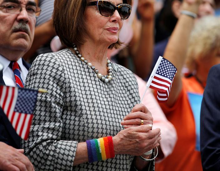 House Minority Leader Nancy Pelosi (D-Calif.) wears a rainbow armband as she attends a news conference accompanied by members of the House Democratic Caucus to call on House Speaker Paul Ryan to allow a vote on gun violence prevention legislation onJune 22, 2016.