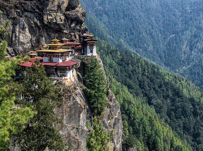 <p>Taktsang Palphug Monastery, nicknamed Tiger's Nest, is a Buddhist temple and the most sacred site in Bhutan. It's built into a steep cliff 3,000 feet above a valley in the Himalayas.</p>