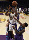 Los Angeles Lakers center Dwight Howard, center, goes up for a shot while Charlotte Hornets guard Malik Monk, right, and PJ Washington defend during the second half of an NBA basketball game in Los Angeles, Sunday, Oct. 27, 2019. The Lakers won 120-101. (AP Photo/Kelvin Kuo)