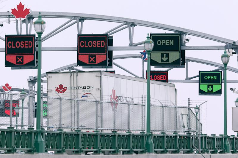 A truck crosses the Peace Bridge in Buffalo, N.Y. into Canada on March 18, 2020. The Canada-U.S. border is closed to non-essential traffic in both directions. (Photo: ASSOCIATED PRESS)
