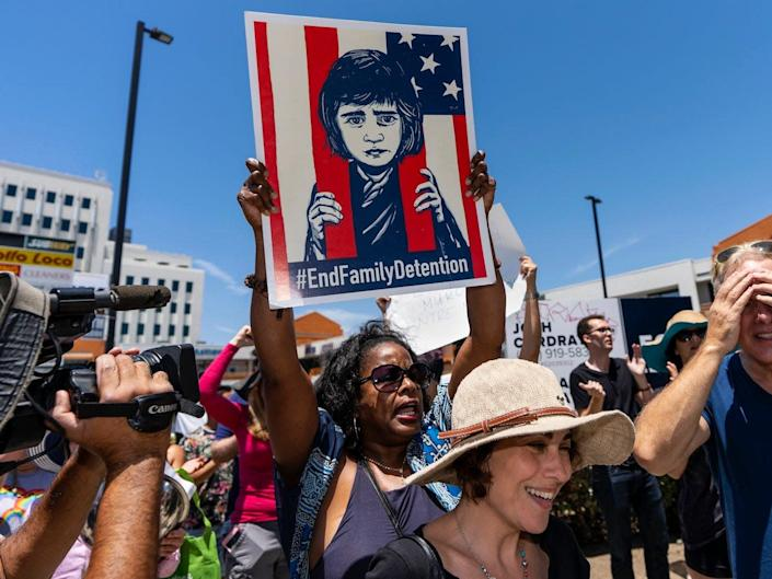 A protester holds a placard during a Close The Camps protest against migrant detention centers in Los Angeles, California, on July 2, 2020.