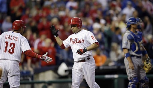 Philadelphia Phillies' Placido Polanco, center, and Freddy Galvis celebrate after Polanco's two-run home run in the third inning of a baseball game against the Los Angeles Dodgers, Monday, June 4, 2012, in Philadelphia. At right is A.J. Ellis. (AP Photo/Matt Slocum)