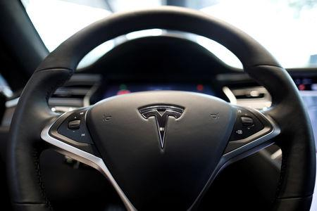FILE PHOTO: The logo of Tesla is seen on a steering wheel of its Model S electric car at its dealership in Seoul