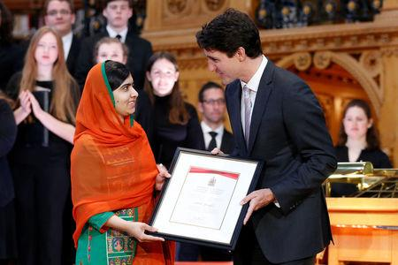 Canada's PM Trudeau presents Pakistani Nobel Peace Prize laureate Yousafzai with honorary Canadian citizenship in Ottawa