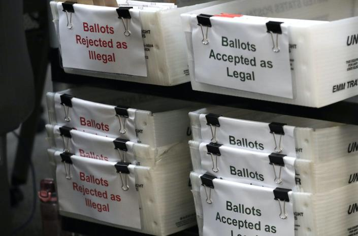 """<span class=""""caption"""">Boxes of illegal and legal vote-by-mail ballots at the Miami-Dade County Elections Department ahead of Florida's Aug. 18 primary election.</span> <span class=""""attribution""""><a class=""""link rapid-noclick-resp"""" href=""""https://newsroom.ap.org/detail/Election2020FloridaMail-In-Ballots/8b27e406c6a748d0b11857f82ee0b35c/photo?Query=ballot%20signature%20florida&mediaType=photo&sortBy=arrivaldatetime:desc&dateRange=Anytime&totalCount=6&currentItemNo=0"""" rel=""""nofollow noopener"""" target=""""_blank"""" data-ylk=""""slk:AP Photo/Lynne Sladky"""">AP Photo/Lynne Sladky</a></span>"""