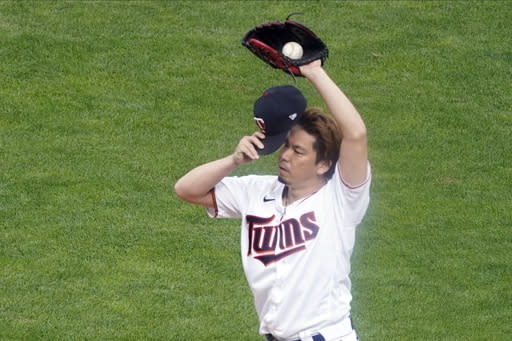 Minnesota Twins pitcher Kenta Maeda, of Japan, composes himself after giving up a walk to Houston Astros' Carlos Correa to load the bases in the fourth inning in Game 1 of the American League wild-card baseball series, Tuesday Sept. 29, 2020, in Minneapolis. (AP Photo/Jim Mone)