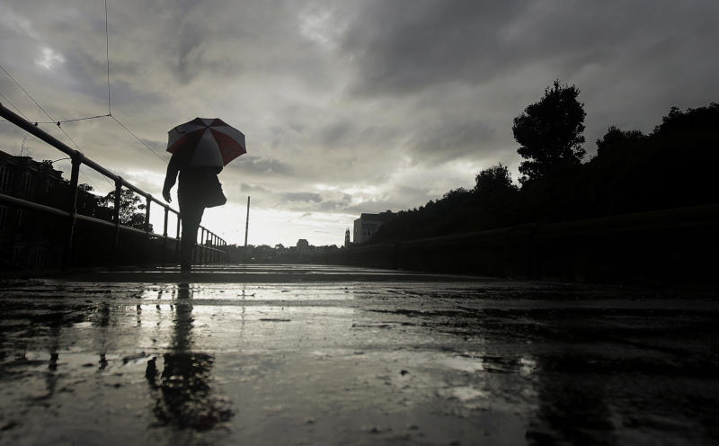 File - In this March 5, 2019, file photo, a man walks with an umbrella in the rain in San Francisco. A cold front traveling down to Northern California from the Gulf of Alaska is expected to dump at least a foot of snow in higher elevations of the Sierra Nevada weeks before the start of summer. National Weather Service meteorologist Brendon Rubin-Oster says the first storm will arrive Wednesday, May 15, 2019, and will continue through Thursday. (AP Photo/Jeff Chiu, File)